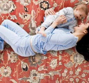 Woman on Rug with Baby